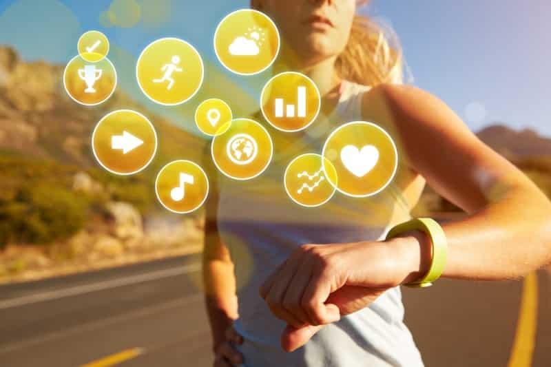women checking activity fitness tracker